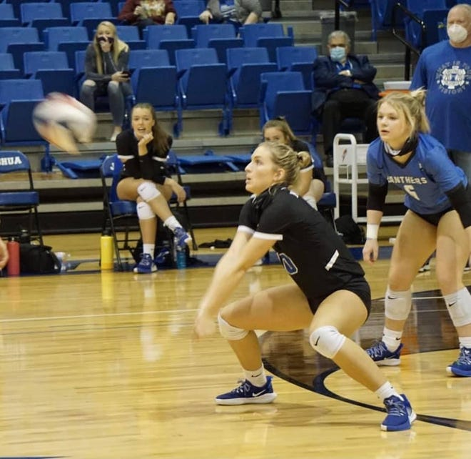 Midlothian's Kenna Buchanan returns a serve during a match at Joshua last November. The Lady Panthers finished 7-2 at the Granbury tournament last weekend.