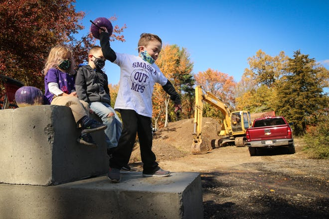 Christopher Hohn, 7, smashes a pumpkin during the pumpkin smash fundraiser at Cedar Hill Farm in Mendon on Oct. 17, 2020. Hohn suffers from Mucopolysaccharidosis (MPS), which is a rare terminal disease. So every year, Hohn and his mother, Emily Viti, participate in the event to bring awareness to MPS.