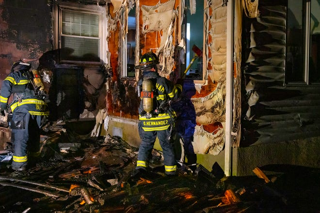 Framingham firefighters searching for fire at a Potter road home on Saturday.
