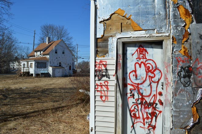 Two of the vacant homes on Leland Street in Framingham that are set to be demolished. The homes were abandoned after they were contaminated by pollution from nearby hazardous waste management company General Chemical.