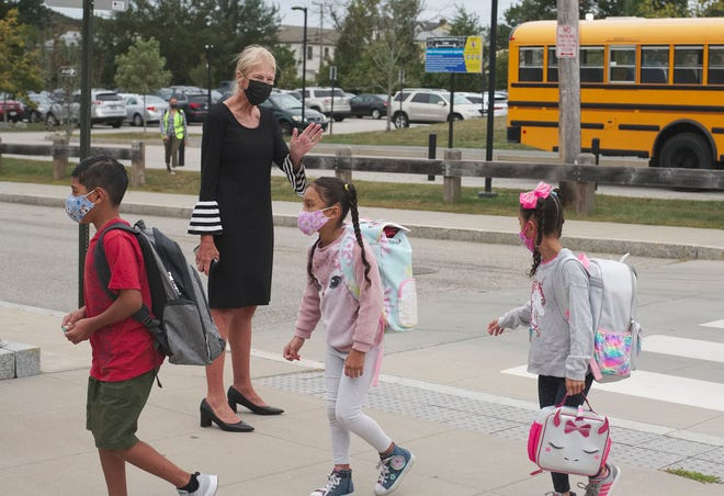 Newport Superintendent Colleen Burns Jermain welcomes Pell Elementary School students on the first day of classes in September.