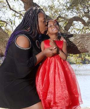 Allison Morris and her daughter Samariah Reign Brown, 5, are thankful for the time they can spend together.