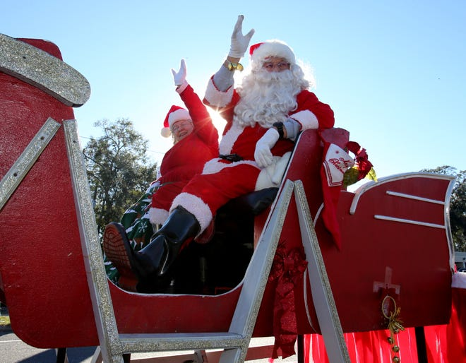 Santa Claus and Mrs. Claus wave to the crowd in this file photo during the 2017 Belleview Christmas Parade in Belleview. Both Belleview and Dunnellon plan on moving forward with their Christmas parades this year. Last week, organizers canceled the Ocala Christmas Parade.