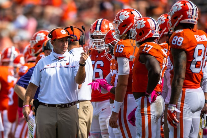 Clemson head coach Dabo Swinney talks to quarterback Trevor Lawrence (16) during a game against Syracuse at Memorial Stadium last month. [Ken Ruinard-USA TODAY Sports]