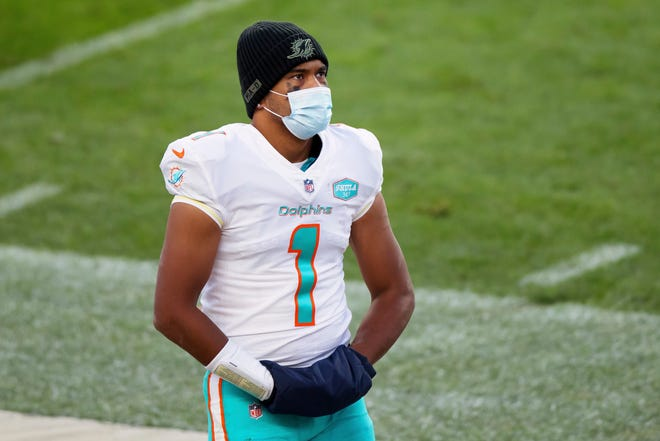 Miami Dolphins quarterback Tua Tagovailoa (1) stands on the sidelines against the Denver Broncos during the second half of an an NFL football game, Sunday, Nov.. 22, 2020, in Denver.