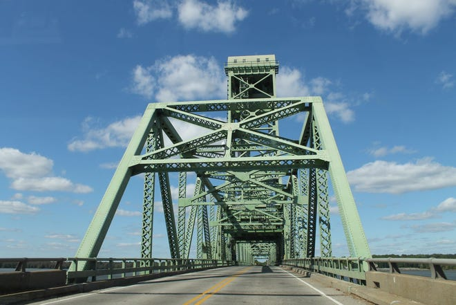 The Benjamin Harrison Memorial Bridge carries state Routes 106 and 156 across the James River between Prince George and Charles City counties.