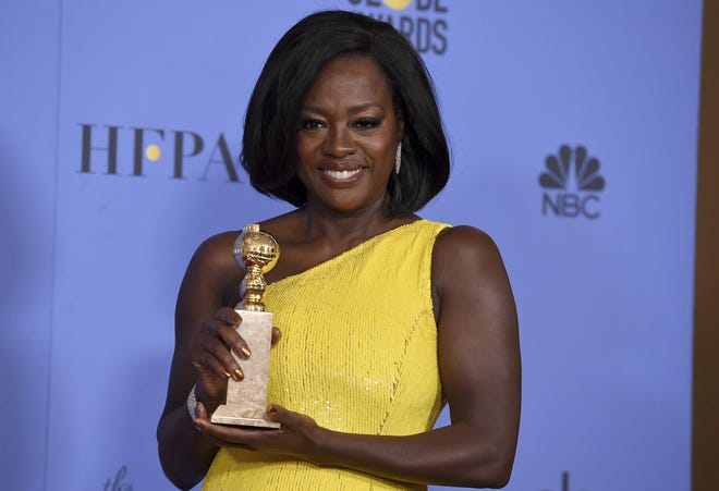 """Viola Davis poses with the Golden Globe award that she received for best performance by an actress in a supporting role in any motion picture for """"Fences"""" at the 74th annual awards ceremony in January 2017 at the Beverly Hilton Hotel in Beverly Hills, Calif. [Invision via AP, file / Jordan Strauss]"""