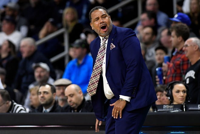 PC coach Ed Cooley reacts to a call during a game against Marquette at the Dunkin Donuts Center in February. The Friars will play their games on campus at Alumni Hall this season.