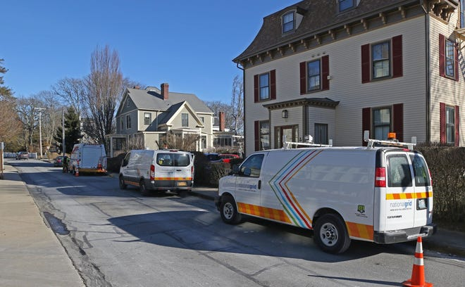 National Grid workers shut off gas to homes on Catherine Street in Newport in January 2019 after an outage caused a loss of heat for customers on Aquidneck Island. [The Providence Journal, file / Steve Szydlowski]