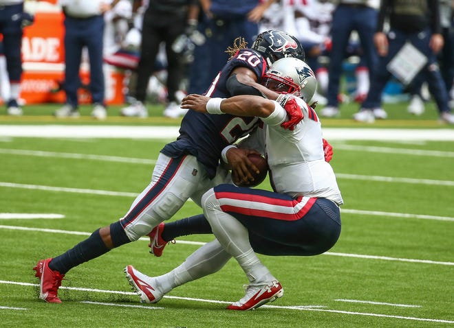 Texans safety Justin Reid (20) sacks Patriots quarterback Cam Newton during the fourth quarter on Sunday at NRG Stadium. [USA TODAY Sports / Troy Taormina]