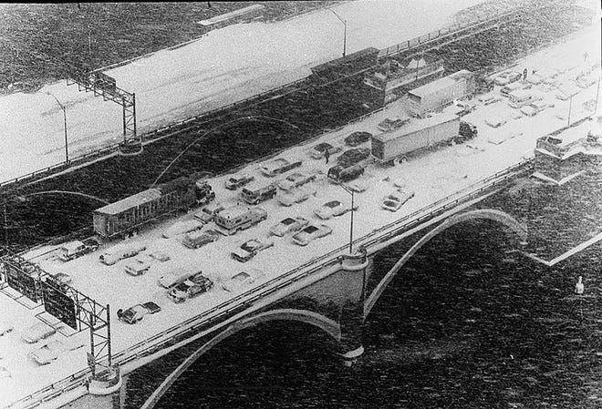Cars litter the Washington Bridge during the Blizzard of 1978, which trapped thousands on their way home from work and brought the entire state to a standstill.