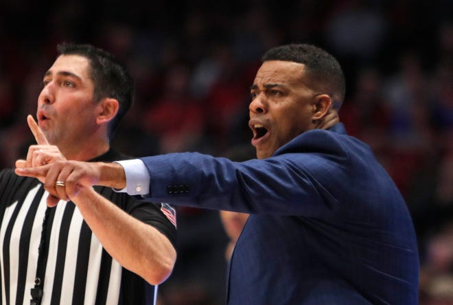 Rhode Island head coach David Cox, shown in a February game at Dayton, says he's praying that his Rams can get through this college basketball season amid the pandemic.