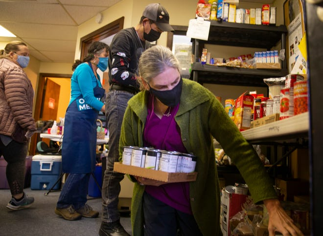 Sue Sierralupe, clinic director of Occupy Medical, searches for supplies as she and staff work to provide necessities to clients in need.