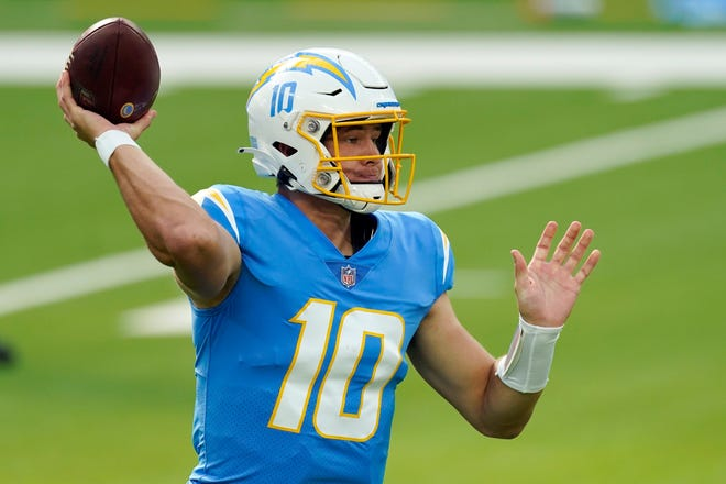 Los Angeles Chargers quarterback Justin Herbert passes against the New York Jets during the first half of an NFL football game Sunday, Nov. 22, 2020, in Inglewood, Calif. (AP Photo/Jae C. Hong)