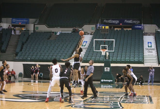 A limited number of fans were in place for the opening tip of McKinley's Division I regional semifinal game against Shaker Heights in March because of COVID-19 restrictions. COVID-19 protocols have postponed a number of Bulldogs games over the next few weeks. (CantonRep.com / Scott Heckel)