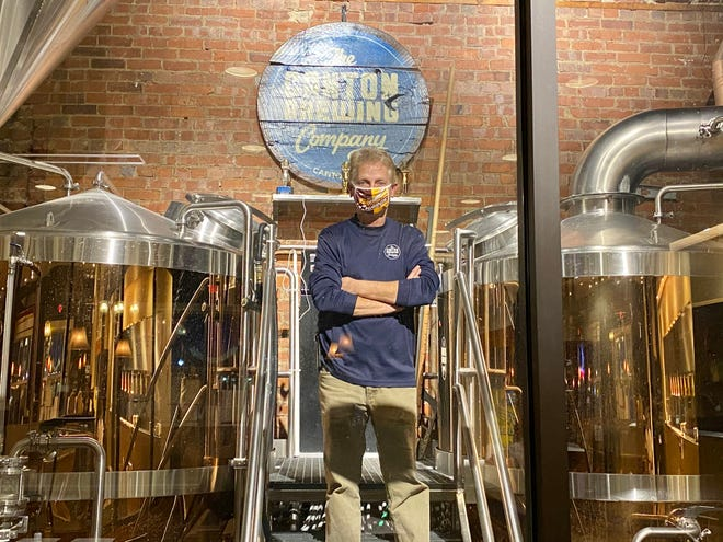 Canton Brewing Company owner Dave Beule stands in the brewing area of the downtown Canton facility.