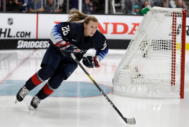 In this Jan. 25, 2019, file photo, United States forward Kendall Coyne Schofield skates during the Skills Competition, part of the NHL All-Star weekend, in San Jose, Calif. The Chicago Blackhawks on Monday hired Coyne Schofield as player development coach. She's the first woman to hold that job in the organization's history. The former U.S. women's national team player will additionally serve as the team's youth hockey growth specialist in Rockford.