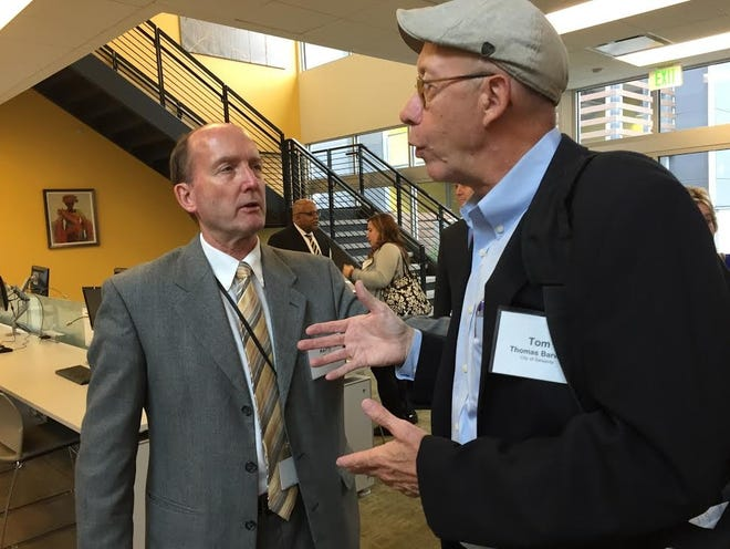 Sarasota City Manager Tom Barwin, right, talks with Salt Lake County Community Services Manager Kerry Steadman at the Bud Bailey Apartment Community in Salt Lake City in 2015.