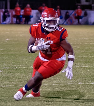 Manatee High running back Kyree Jones turns upfield with a screen pass Friday night against the Stuart Martin County Tigers.