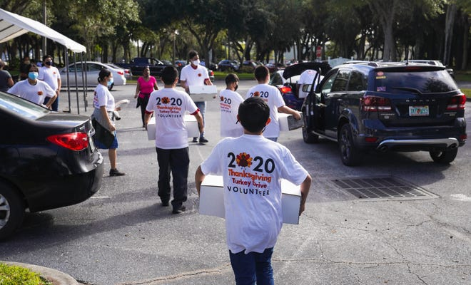 Safe Children Coalition volunteers distribute 700 Thanksgiving meals to 700 families in Sarasota on Saturday.