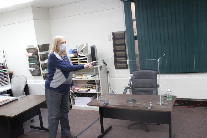 Presiding judge Karen Dixon show the pexiglass being used at the witness stand in one of the jury rooms at the Siskiyou County Courthouse.