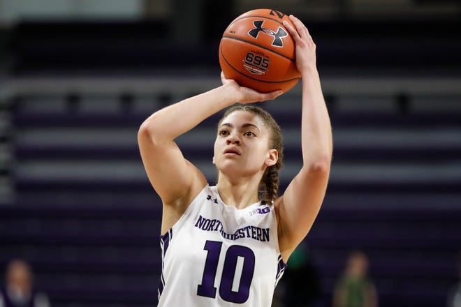 Northwestern guard Lindsey Pulliam (10) shoots a free throw against Colgate in Evanston, Ill., on Nov. 27, 2019.