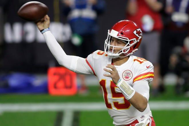 Kansas City Chiefs quarterback Patrick Mahomes (15) throws Sunday in Las Vegas.