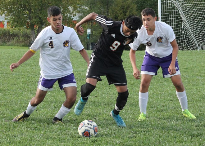 Kewanee High School career goal-scorer Santos Contreras is defended by two Mendota players in a high school soccer match from 2019. The addition of Mendota and Monmouth-Roseville to the Three Rivers Conference raises the prospect of boys soccer becoming a league sport.