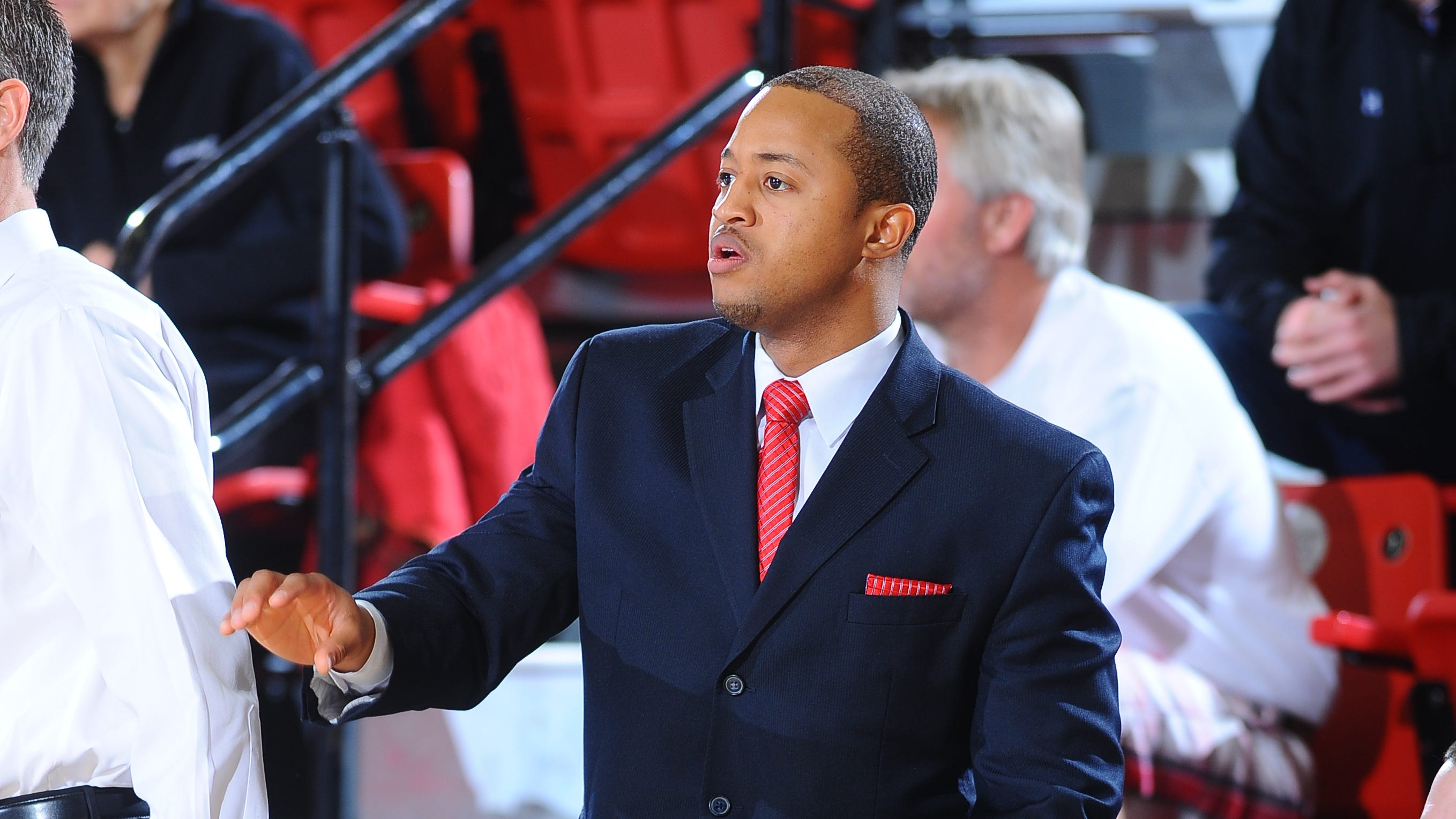 Gardner-Webb assistant coach Takayo Siddle gives instructions during a January 2014 game against Charleston Southern.