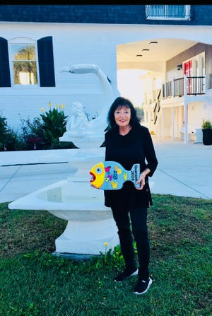"""Lois Andrews received the Splice the Mainbrace award for """"merriment after completing hard work"""" at the Fall Appreciation Event. The award was well deserved as Lois championed 32 Saturday afternoon Quarantinis over the past months. [CONTRIBUTED PHOTO]"""