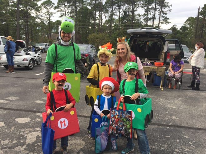 A big thanks to Morgan Taggart for once again creating and managing the Trunk or Treat event on October 31 for our Fairfield Harbour kids and adults! There was a large assortment of creatively decorated trunks and golf carts for the kiddies to enjoy. The costumes and trunks were better than ever, as evidenced by this family of Mario Brothers, and everyone had a great time, even while practicing good social distancing and reduced contact practices.[CONTRIBUTED PHOTO]