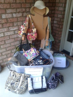 Joan Campbell collected purses on her front porch for the New Bern Woman's Club Precious Purses drive. [CONTRIBUTED PHOTO]