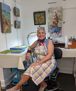 Fairfield Harbour resident Brenda Gear poses in her art studio. [CONTRIBUTED PHOTO]