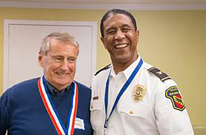 Volunteer Gerald Mackle poses with New Bern Police Chief Toussaint Summers Jr. [Contributed photo]