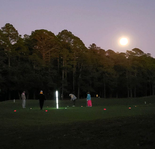 Glow Ball golfers got a little help in the dark from the full moon. [CONTRIBUTED PHOTO]