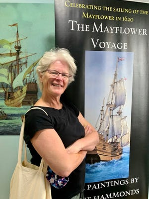 Fairfield Harbour cyclist Nancy Difede posed at the Mayflower Museum in Plymouth, England. [CONTRIBUTED PHOTO]