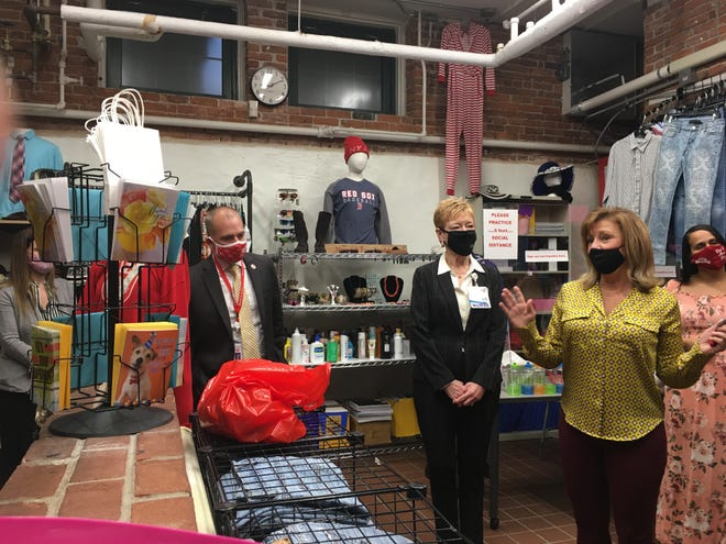 NFA Head of School Brian Kelly with Donna Handley, president of The William W. Backus Hospital, and Shirley Kutia, who oversees the NFA Wildcat Loft and food pantry. The group met on Monday to announce a $10,000 Backus donation to the store and pantry.