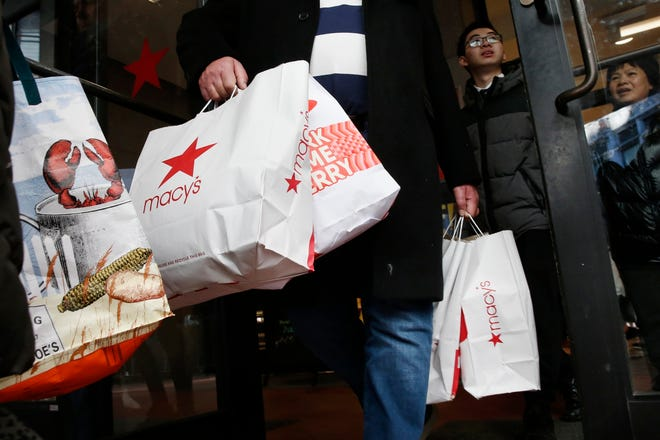 Shoppers leave Macy's in Boston last year. This year's Black Friday shopping event will be much different from ever before. Retailers will be enforcing social distancing, many stores will be closed on Thanksgiving Day and shoppers will be scooping up deals via their computer screens.