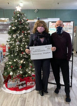 The Philip J. Weihn Youth Foundation donated $2,500 to WHEAT Community Services' Feed-A-Family Program that will serve nearly 600 families this year. Jodi Breidel, North County regional director of WHEAT accepted the ceremonial check from Brian McNally Philip J. Weihn Youth Foundation board member.