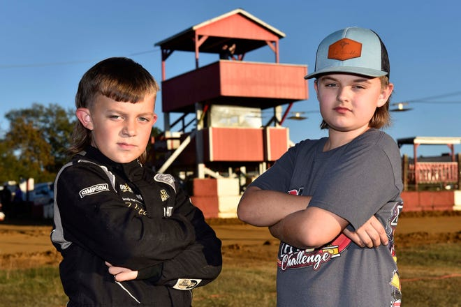 Junior sprint racers Wyatt Kitchen, left, and Sawyer Davis stand in the infield at Rockfish Speedway. The two have swapped leads in many junior sprint races in the region this year.