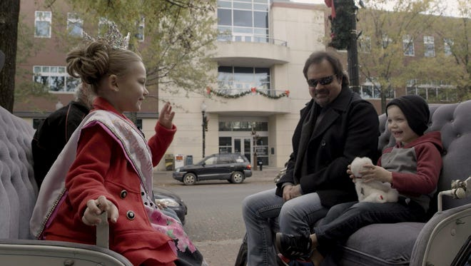 Country singer Larry Stewart is shown in a scene from his video 'Don't Save it all for Christmas Day,' which was shot in downtown Fayetteville. [CONTRIBUTED PHOTO]