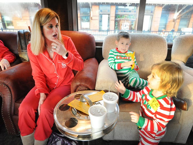 Families travel in pajamas during the journey to the North Pole on the Polar Express from the Dennison Depot.