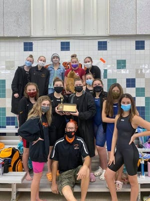 The Wellsville Sea Lions celebrate after winning the program's first-ever Section V swimming title Saturday.
