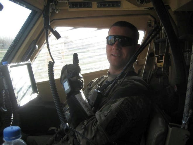 Scott Milley, who was killed in action in 2010, in a humvee in Afghanistan