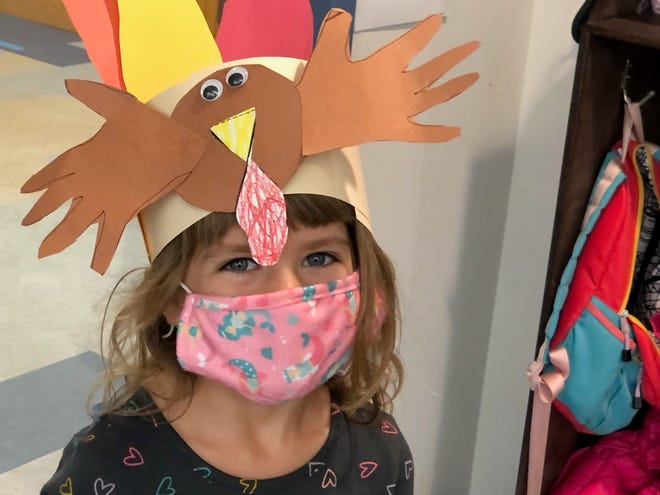 An Eastham Elementary School kindergartener wears the Thanksgiving headband she made in Mrs. Stewart's class.