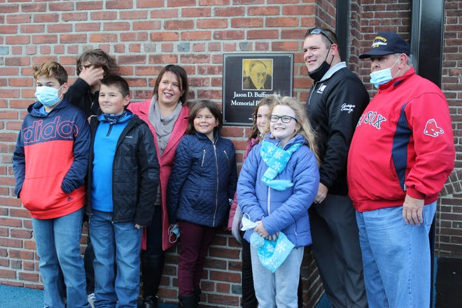 Boys and Girls Clubs of Metro South dedicated the new playground at their Taunton Clubhouse in memory of Jason Buffington, a longtime board member and former Taunton City Solicitor who passed away earlier this year at the age of 45 after a battle with pancreatic cancer Nov. 19. Pictured is the Buffington family.