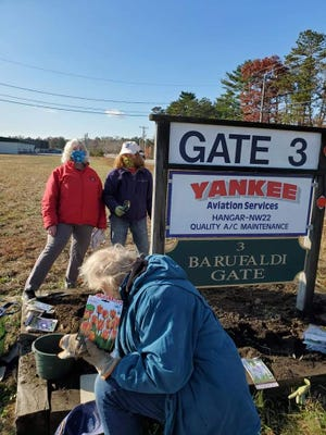 Jean Nalen-Dobachesky, Pat O'Brien and Linda Souza participated in the airport planting event.