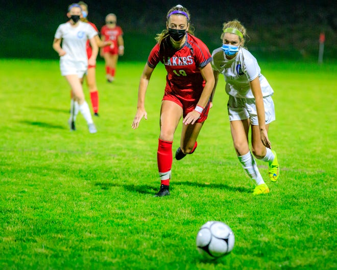 Rachel Ryan, left, chases after the soccer ball with Quincy's Mairead Folan.