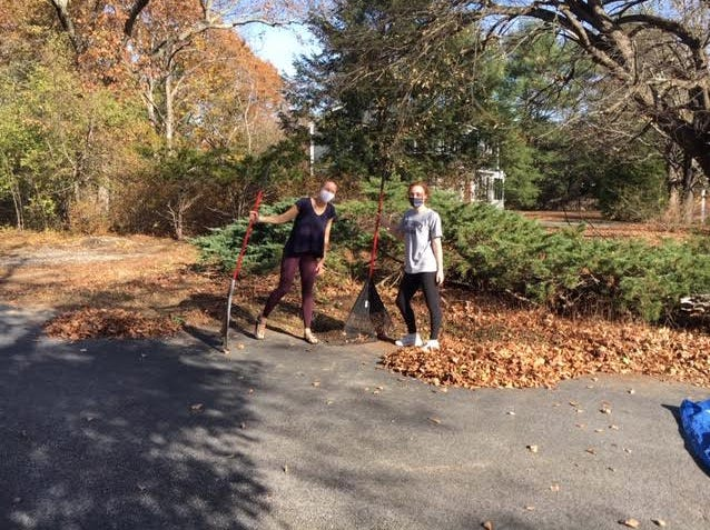 Ms. Pooler's Honor Society students at Concord Carlisle High School took time away from their studies to pitch in with much needed yard work at over a dozen homes of Concord senior residents.