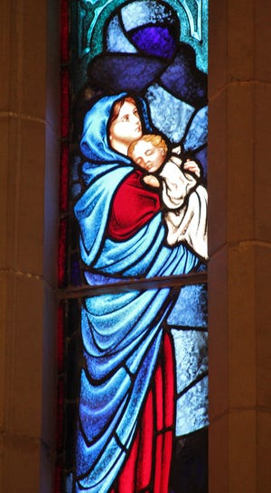 In less than a month, Christmas will be celebrated. A stained glass window at Grace Lutheran Church depicts Mary with the baby Jesus.